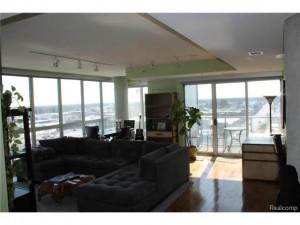 Living area w/walnut flooring throughout